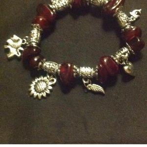 Jewelry - Charm bracelet with garnet colored stones